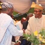 Mr. Babatunde Fashola SAN (left) exchanging pleasantries with former Head of State, General Muhammadu Buhari GCFR