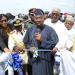PRESIDENT GOODLUCK JONATHAN (M) CUTTING THE TAPE TO INAUGURATE THE NIGERIA NAVY SHIPS, OKPABANA; CENTENARY; SAGBAMA AND PROSPERITY AT THE NAVAL DOCKYARD, VICTORIA ISLAND, LAGOS. WITH HIM ARE: PDP NATIONAL CHAIRMAN. ALHAJI ADAMU MU'AZU; MINISTER OF DEFENCE, GEN ALIYU GUSAU; CHIEF OF NAVAL STAFF, VICE-ADMIRAL USMAN JIBRIN; CHAIRMAN, SENATE COMMITTEE ON NAVY, SEN CHRS ANYANWU AND OTHERS