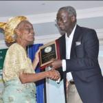 Lagos State Governor, Mr.  Babatunde Fashola, SAN (right) presenting an award to Mrs. Florence Ibigoke Kukoyi (left) who received it on behalf of Professor Alele Williams