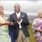 Lagos State Governor, Mr.  Babatunde Fashola, SAN (middle) presenting an award to Mrs. Florence Ibigoke Kukoyi (left) who received it on behalf of Professor Alele Williams while Commissioner for Education, Mrs. Olayinka Oladunjoye (right) looks on with admiration