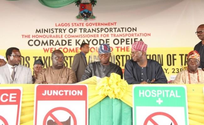 Lagos State Governor, Mr. Babatunde Fashola, SAN (2nd left), Commissioner for Transportation, Comrade Kayode Opeifa (middle), President, Lagos State Taxi Cab Association, Prince Tajudeen Adetoro (2nd left), Chairman, Modern Cab Association, Mr. Adegboye Ajakaye (left) and Oba Alara of Ilara, Oba Akeem Adesanya (right)