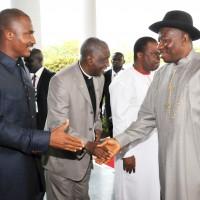 FROM LEFT: EXECUTIVE SECRETARY, NIGERIAN CHRISTIAN PILGRIMS COMMISSION, MR JOHNKENNEDY OPARA; CHAPLAIN ASO VILLA CHAPEL, VEN. OBIOMA ONWUZURUMBA; AND CHIEF OF STAFF, BRIG.-GEN JONES AROGBOFA WELCOMING PRESIDENT GOODLUCK JONATHAN TO THE 5TH PRESIDENTIAL PRAYER BREAKFAST