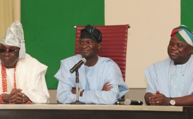 Lagos State Governor, Mr. Babatunde Fashola, SAN (middle), Governor-elect, Mr. Akinwunmi Ambode (right) and the Oba of Lagos, Oba Rilwan Akiolu I (left)