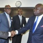 Lagos State Governor, Mr. Akinwunmi Ambode (right) in a warm handshake with Representative of Department of Petroleum Resources (DPR), Mr. Tunji Atiba (left)