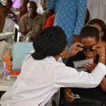 Undergoing eye examination