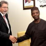 Vice President Yemi Osinbajo  in a handshake with the Italian Ambassador to  Nigeria, Mr. Fulvio  Rustico