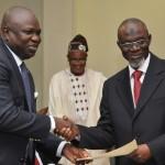 Lagos State Governor, Mr. Akinwunmi Ambode (left), congratulating Chairman, Audit Service Commission, Alhaji Waliu Abiodun Onibon