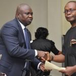 Lagos State Governor, Mr. Akinwunmi Ambode (left), congratulating Executive Secretary, Wharf Landing Fee Collecting Authority, Mr. Joe Igbokwe