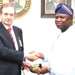 Lagos State Governor, Mr. Akinwunmi Ambode (right), presenting a state plaque to the Vice Chancellor, Pan-Atlantic University, Prof. Juan Elegido