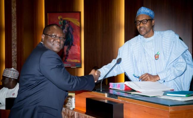 President Muhammadu Buhari congratulating Alh.Mahmoud Isa-Dutse