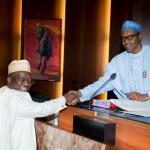 President Muhammadu Buhari congratulating Mr. Olakunle Bamgbose