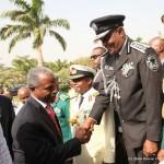 Inspector General of Police Solomon Arase salutes Vice President Yemi Osinbajo