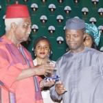 Vice President Yemi Osinbajo presenting an award, ICON Of Democracy to former Vice President, Alex Ekwueme
