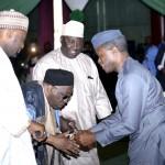 Vice President Yemi Osinbajo in handshake with Maitama Sule