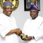 Lagos State Governor, Mr. Akinwunmi Ambode (right), presenting a State plaque to the Minister of Interior, Lt. Gen. Abdulrahman Dambazau (rtd.)