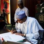 President Buhari signs condolence book of Late James Ocholi (SAN) as he presides over The Federal Executive Council