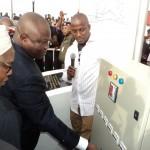 Lagos State Governor, Mr. Akinwunmi Ambode (middle), switching on the power circuit to light up the Lagos-Abeokuta Expressway (Ile Zik – Toll Gate, Sango Ota)