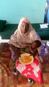 Amina Ali Nkek with her baby