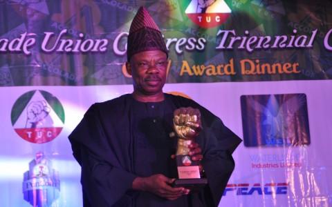 Senator Ibikunle Amosun, displaying the Excellence Award