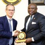 Lagos State Governor, Mr. Akinwunmi Ambode (right), presenting a State plaque to the Managing Director/C.E.O, Total E&P Nigeria Limited, Mr. Nicolas Terraz (left)