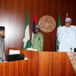 President Muhammadu Buhari confers with the Vice President Prof Yemi Osinbajo