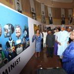 On PHOTO EXHIBITION TOUR: A Young female artist explaining her works to President Muhammadu Buhari accompanied by the Vice President Prof Yemi Osinbajo on Photo exhibition tour