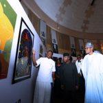 On PHOTO EXHIBITION TOUR: Isaac IK Emokpae explaining his works to President Muhammadu Buhari accompanied by the Vice President Prof Yemi Osinbajo on Photo exhibition tour
