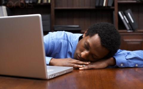 Businessman Sleeping on the Job --- Image by © Sean Justice/Corbis