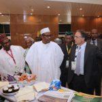 President Muhammadu Buhari accompanied by NESG Chairman Alhaji Kyari Bukar left and Flour Mills Manager Mr John Coumantaros visit Flour mills stand
