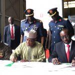 L-R;  Signing the handover doc; Chief of Air Staff, Air Marshall Sadique Abubakar, Minister of Defence, Brig General Mansur Dan-Ali and NSA, Major General Babagana Mongonu