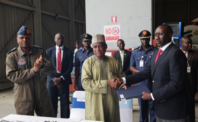 L-R;   handover doc; Chief of Air Staff, Air Marshall Sadique Abubakar, Minister of Defence, Brig General Mansur Dan-Ali and NSA, Major General Babagana Mongonu