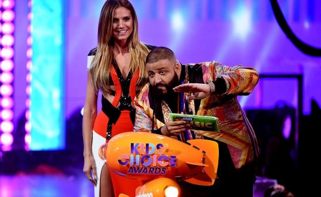 Model Heidi Klum (L) and DJ Khaled speak onstage