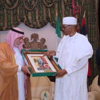 2 PRESIDENT MUHAMMADU BUHARI PRESENTING A GIFT TO THE OUT GOING AMBASSADOR OF SAUDI ARABIA TO NIGERIA, H.E. FAHAD BIN ABDULLAHI SEFYEN