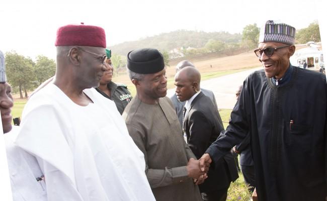 R-L; President Muhammadu Buhari in a hand shake with Vice President Yemi Osinbajo, Chief of Staff, Mallam Abba Kyari on arrival