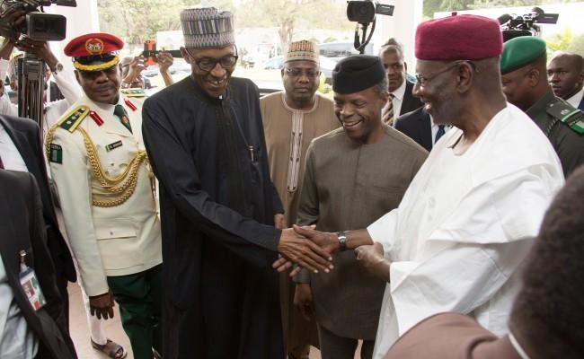 L-R; President Muhammadu Buhari in a handshake with Vice President Yemi Osinbajo, Chief of Staff Mallam Abba Kyari