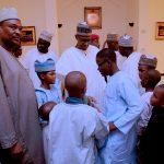 PRESIDENT BUHARI ATTENDS JUMA'AT PRAYER 3A&B. President Muhammadu Buhari chats with Children after Juma'at prayer at the Aso Villa in Abuja. PHOTO; SUNDAY AGHAEZE. APRIL 21 2017.
