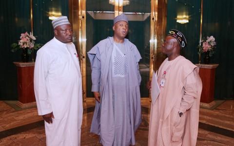 President of the Senate Dr Bukola Saraki (M) flanked by the SSAP on NASS (Senate) Senator Ita Enag and ssap on NASS (House of Rep), How Sulieman Kwao