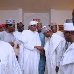 L-R; NSA Maj Gen Babagana Mongonu, President Muhammadu Buhari (M) in a hand sjhake with Minister of Justice and Attorney General Abubakar Malami