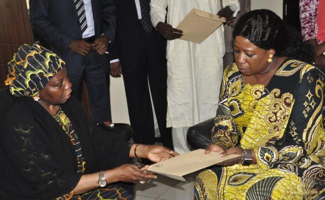 Dr. Hajo Sani presenting Mrs. Buhari's condolence letter