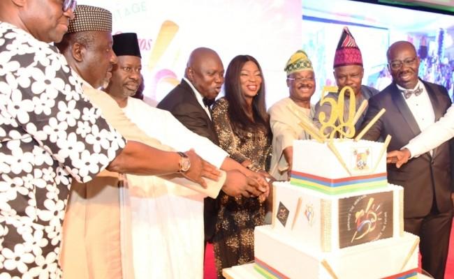 L-R: Governors -  Mr. Ayo Fayose (Ekiti State); Owelle Rochas Okorocha (Imo State); Alhaji Ibrahim Dankwambo (Gombe State); Mr. Akinwunmi Ambode (Lagos State); his wife, Bolanle;  Sen. Abiola Ajimobi (Oyo State); Sen. Ibikunle Amosun (Ogun State) and Mr. Godwin Obaseki (Edo State) cutting the cake