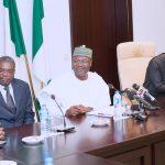 R-L; Acting President Yemi Osinbajo, Chairman INEC Nigeria Professor Mahmood Yakubu, Chairman of the Electoral Commission of Benin Republic and Roger Addah