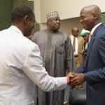 Hon. Minister of Power, Works & Housing, Mr Babatunde Fashola, SAN(right), Minister of State, Hon. Mustapha Baba Shehuri (middle) and Managing Director, Federal Mortgage,  Mr Gimba Ya'u Kumo(left) shortly