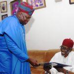 Lagos State Governor, Mr. Akinwunmi Ambode (left), presenting a card to the celebrant, Alhaji Hassan Fasinro