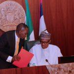 R-L; President Muhammadu Buhari confers with the NSA Major Gen Babagana Mongonu