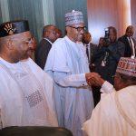 President Muhammadu Buhari (M) flanked by Akwa Ibom State Governor, Mr. Udom Emmanuel and Adamawa State Governor, Alhaji Mohammed Jibrilla Bindow