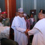 President Muhammadu Buhari (M) flanked by Akwa Ibom State Governor, Mr. Udom Emmanuel Bauchi State Governor, Alhaji Mohammed Abdullahi Abubakar