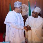 President Muhammadu Buhari in a handshake with former Head of State, Chief Olusegun Obasanjo