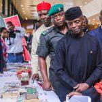 Vice President Yemi Osinbajo inspects some anti-corruption exhibit.