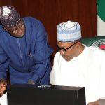 President Muhammadu Buhari confers with the SGF Mr Boss Mustapha