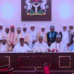 President Muhammadu Buhari (M) flanked by Ooni of Ife Oba Adeyeye Ogunwusi and Chief of Staff Mallam Abba Kyari and others
